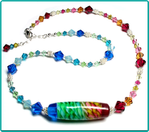 Unique asymmetric rainbow colored lampwork and crystal necklace
